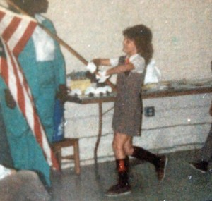 Trudy serving as a flag-bearer in her Brownie Girl Scout outfit.