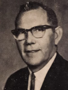 Beranek in 1970, with horn-rimmed glasses and in a suit